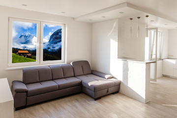 Living room with wide big windows typical for mountain style