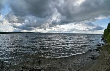 dark gray sky over the restless lake