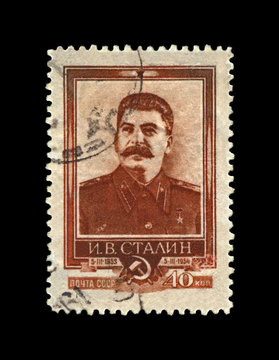 Joseph Stalin, famous soviet politician leader, 1st anniversary of the death, circa 1954. vintage canceled postal stamp printed in USSR (Soviet Union) isolated on black background.