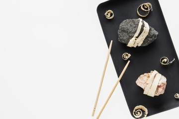 The concept of natural food. Abstract sushi made from stones and wood.
