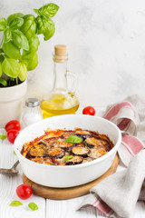 Eggplant casserole with tomato sauce, white cheese, tasty summer stew