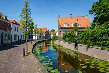 A canal in the beautiful historic center of the old village of Maasland, the Netherlands. Maasland is a village in the province of South Holland, the Netherlands