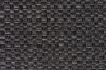 Strict dark textile background with contrast surface.