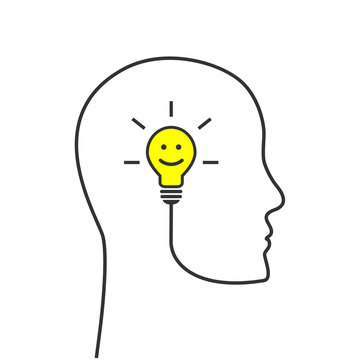 Smiling lightbulb with head silhouette made of wire as positive thinking, optimism and happiness concept