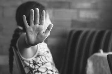 Little girl shows stop. Children violence and abused concept.