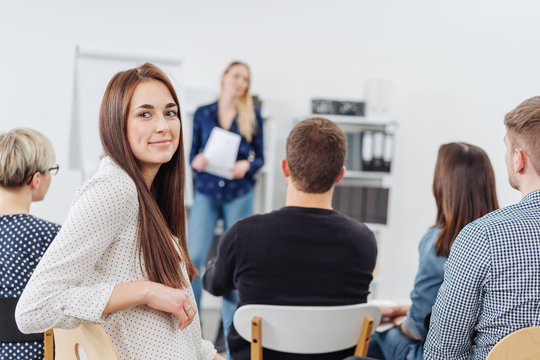 Young woman in a lecture turning to camera
