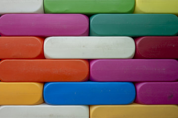 Abstract Background. Background with different colorful shapes plastic blocks . Geometric shapes in different colors.