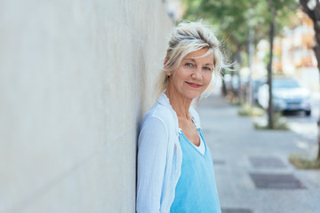 Street portrait of mature smiling blonde woman