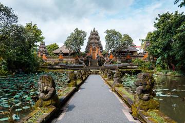 Beautiful symmetrical view of Pura Taman Saraswati or Saraswati Temple surrounded by lotus pond and Plumeria trees in Ubud, Bali, Indonesia