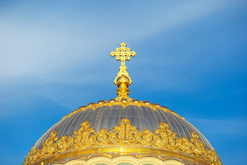 Golden cross on the dome of the temple