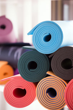 Yoga mats in a pile
