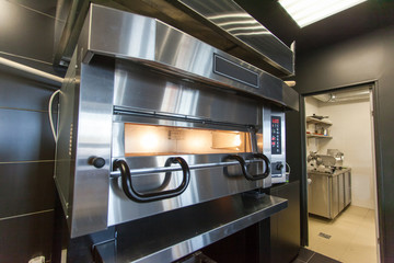 A modern oven for baking pizza in a restaurant