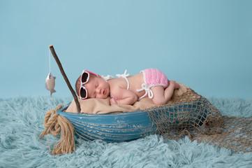 Newborn Baby Girl Sleeping in a Fishing Boat