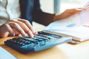 Business man Accounting Calculating Cost Economic Financial data analyzing counting