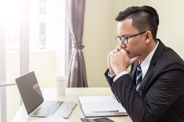 Business man talking in smartphone to discuss idea with sale report on the table so stressed