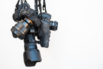 Pile of modern DSLR cameras on white isolate background, how to choose dslr camera concept such as full frame , mirrorless ,micro four thirds 4/3 sensor.