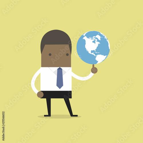 African businessman spinning globe
