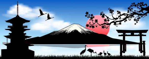 Mount Fuji, the morning sunrise.. Mount Fuji against a blue sky and white clouds.