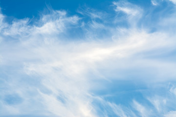 White clouds on the blue sky.