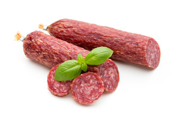 Salami smoked sausage, basil leaves and peppercorns isolated on white background.