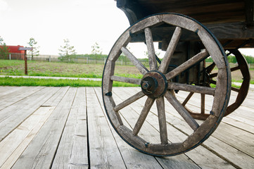Wooden wheel of old cart
