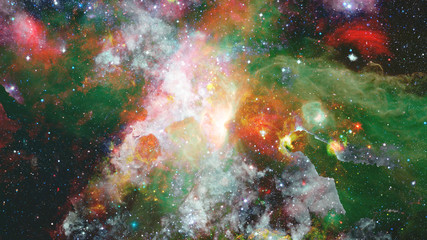 Star field and nebula in deep space. Elements of this image furnished by NASA.