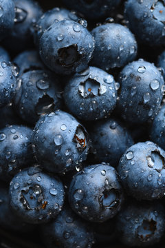 Top view macro shot of fresh blueberry with water drops