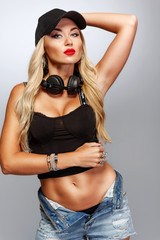 Beautiful Blonde girl DJ posing on camera for poster