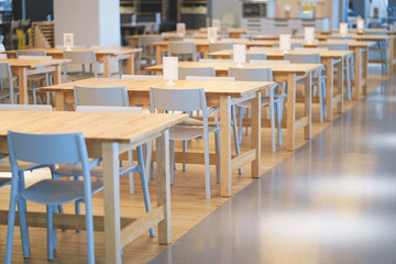 Interior of wooden table in food court shopping mall. Food center in department store.