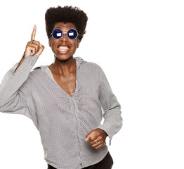 young handsome afro american guy stylish hipster pointing up happy isolated on white background. people ideas concept