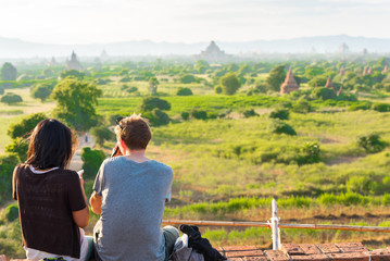 Couple against the background of the landscape and pagodas in Bagan, Myanmar.