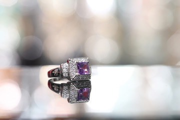 Purple gemstone on diamond ring
