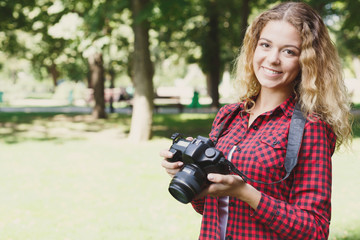 Woman taking photos while standing in the park