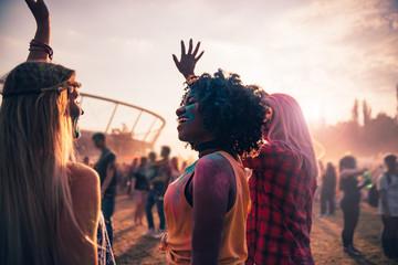 Multiethnic friends celebrating summer holi festival