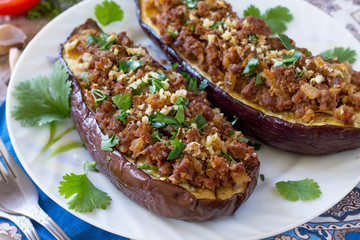 Papiers peints Plat cuisine Classic baked eggplant close-up with meat, walnut and vegetables. Traditional middle eastern or arab dish.