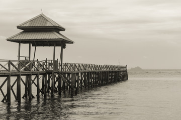 Pier in Mabul Island, Borneo, Malaysia. Black and white photography. Wooden structure by the sea
