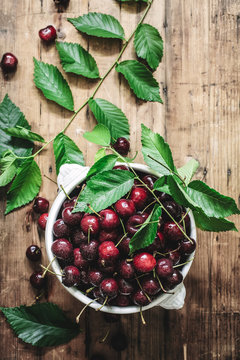 Overhead view of cherries on wooden table