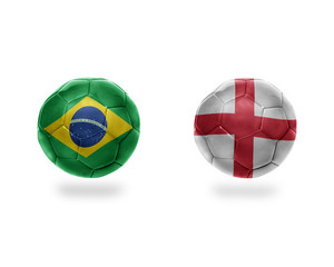 football balls with national flags of brazil and england.