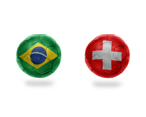 football balls with national flags of brazil and switzerland.
