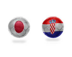 football balls with national flags of japan and croatia.