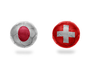 football balls with national flags of japan and switzerland.