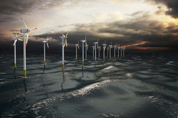 Wind turbines generating electricity on the ocean. Eco power, storm water.