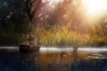 Fishing. Man fishing on a lake on boat
