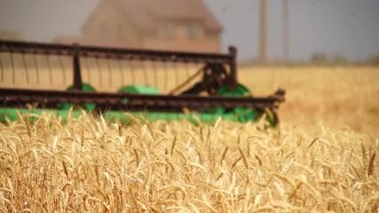 Etiqueta Engomada - Close up of combine harvester for harvesting wheat. Slow motion