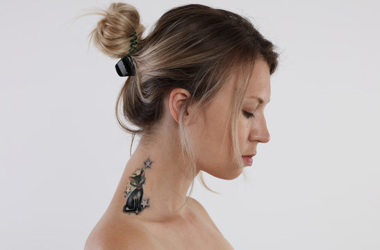 Portrait of young woman tattoo on her neck. Laser tattoo removal concept