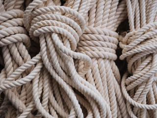 Stacks of white ropes in close-up