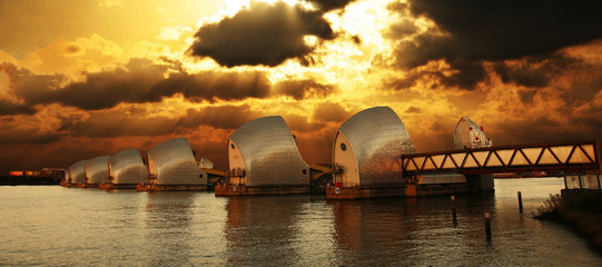 London River Thames Flood Barrier over dramatic sunset.