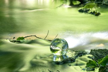 Crystal ball in a river in the spring
