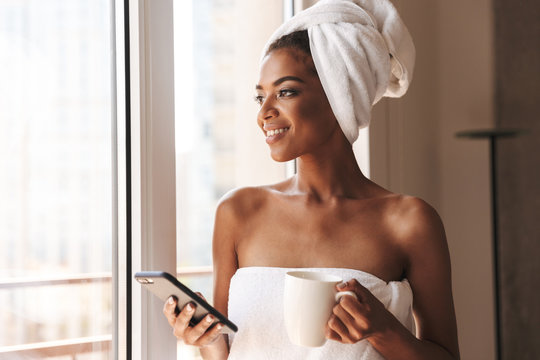 Pretty african woman wrapped in a towel