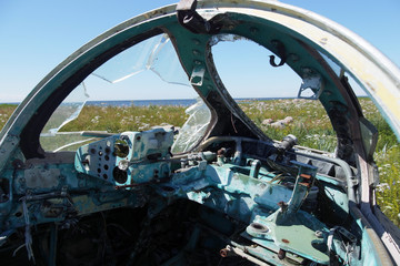 Cockpit of wrecked military aircraft. Blisters are broken